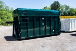 Green chipper with hooklift style hookup and single side swing doors