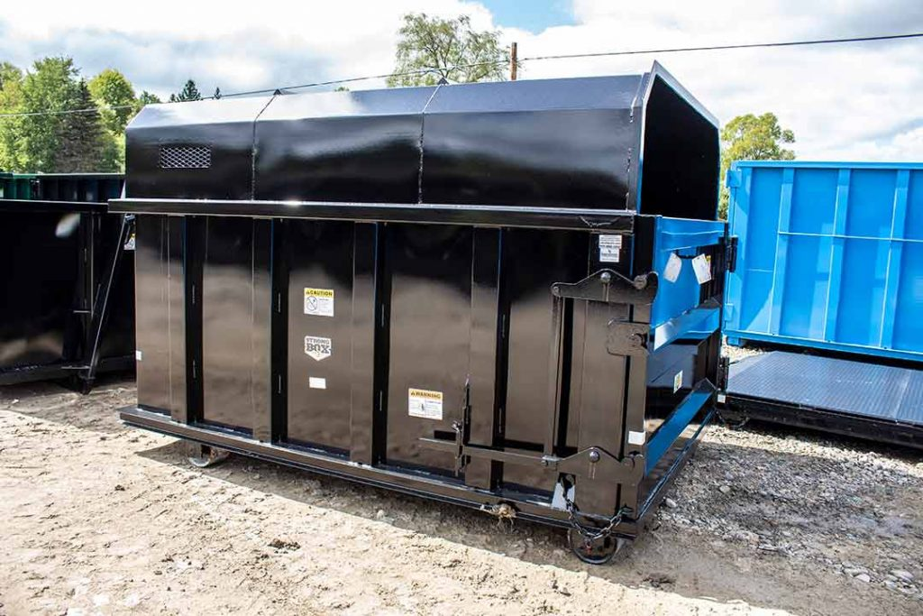 Black chipper style roll-off container with cable hookup
