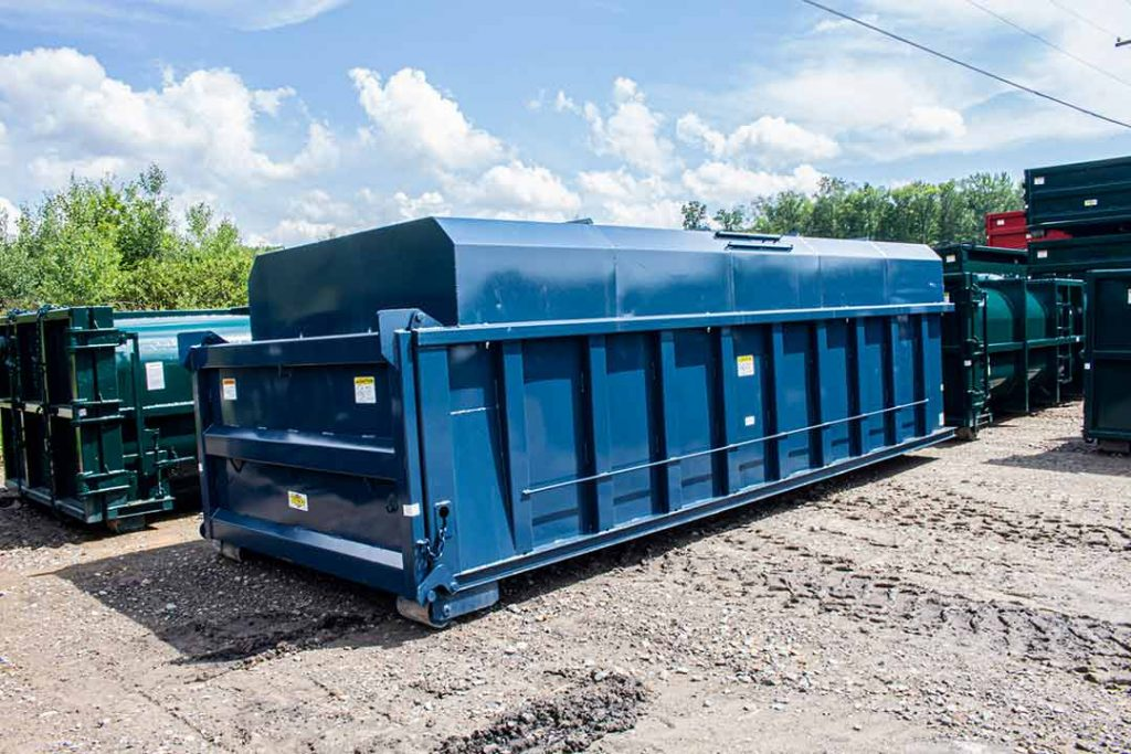 Blue chipper with dump style tailgate and hooklift hookup