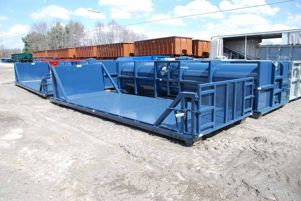 Custom Box Blue flatbed roll off container with expanded cable bulkhead and standard bulkhead with exposed cable hookup