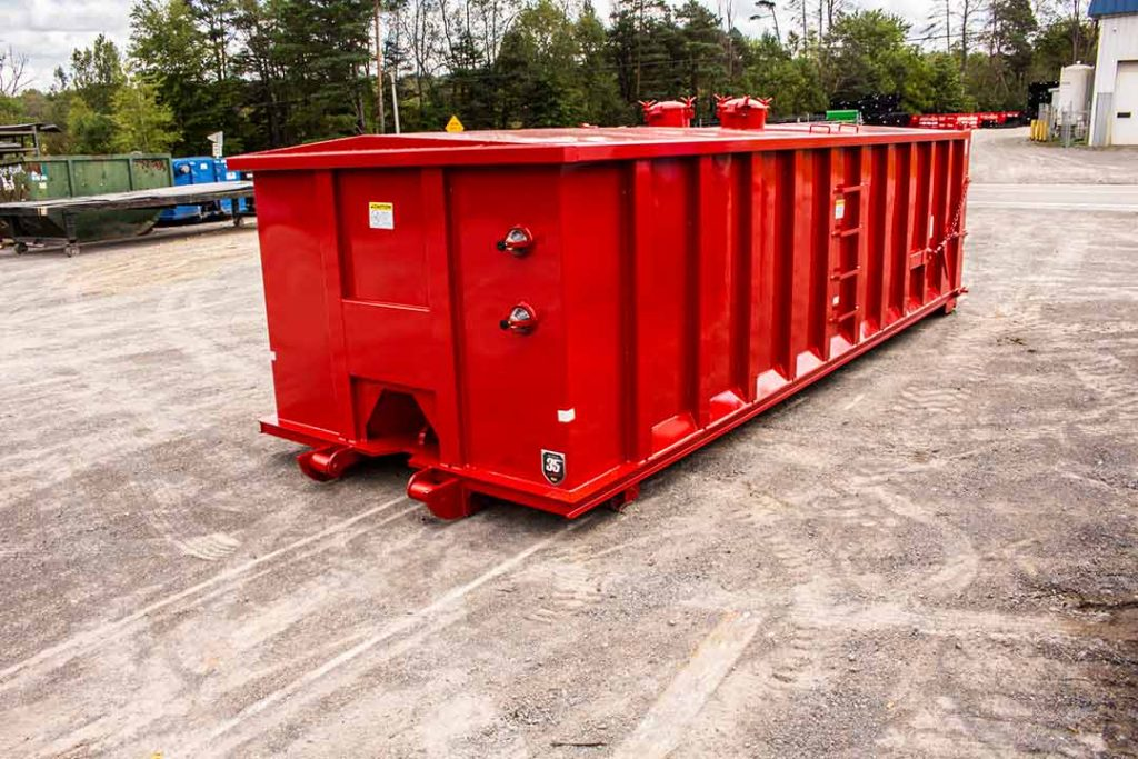 Red Custom Box rolloff container with sight glass, peak roof, manways, sealed tailgate, dirt shedders, and cable style hookup