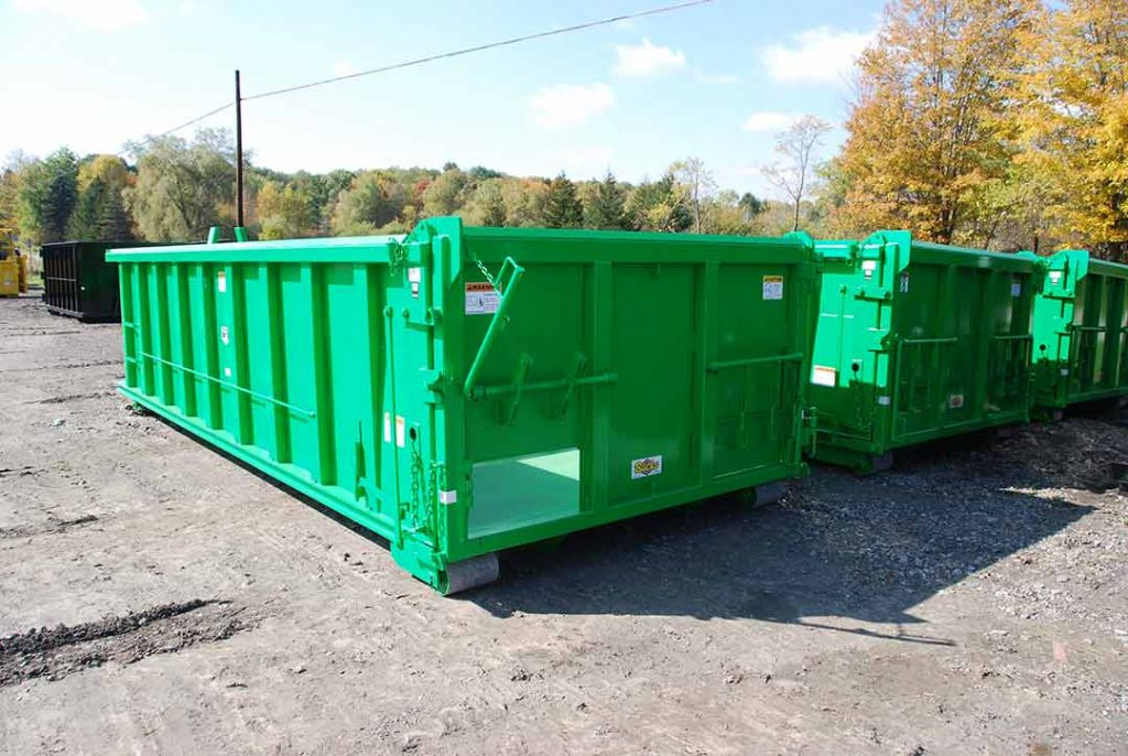 Green dump body with hooklift style roll-off container, two coal chutes on tailgate, and dump style tailgate