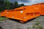 Orange dump body roll-off container with board pockets, dump style tailgate, and dirt shedders