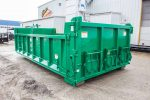 Green dump body roll-off container with hooklift style hookup, board pockets, coal chutes, and dump style tailgate