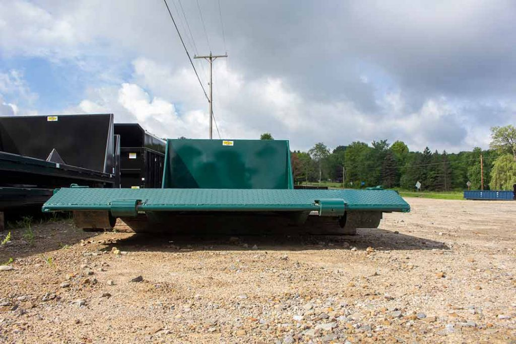 Green flatbed roll-off container with one foot beavertail