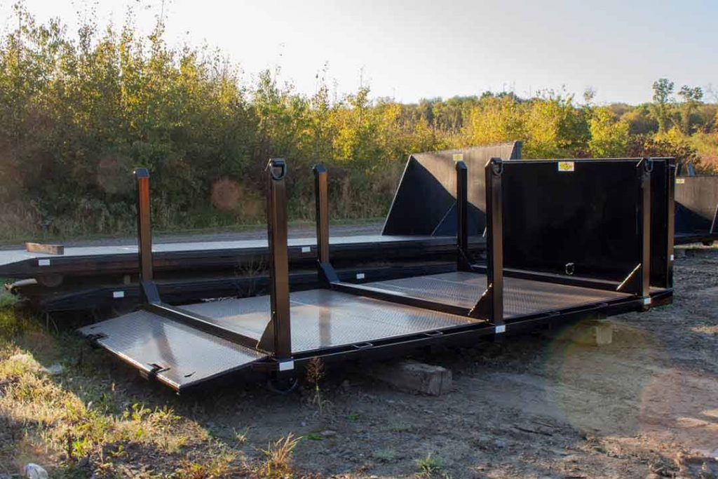 Black Flatbed rolloff container with beavertail and permanent side posts with D-Rings on each post