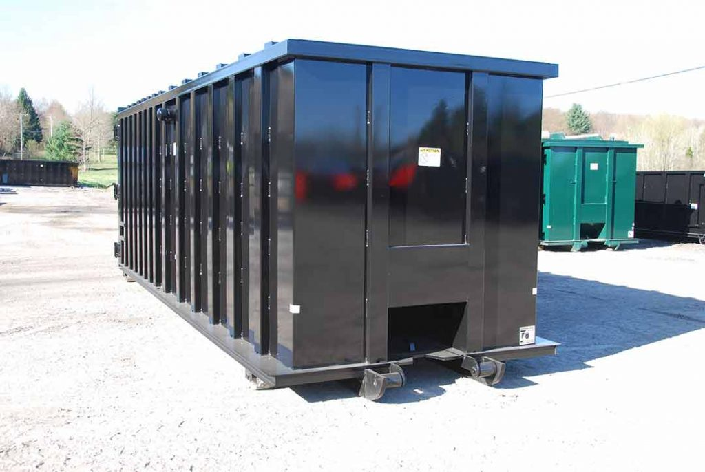 Black rectangular packer roll-off container, or rectangular compactor receiver, with cable style hook