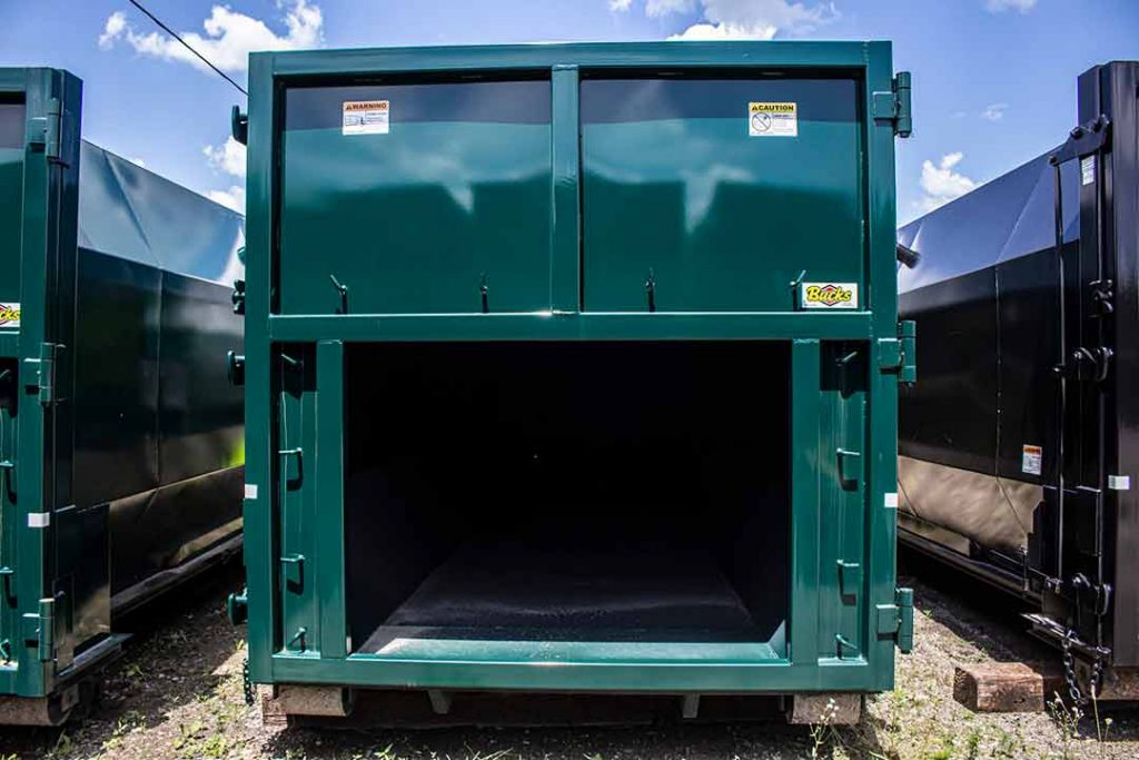 Green octagon packer, or compactor receiver, showing the tailgate of the container with the rectangular opening