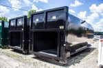 Black octagon packers, or compactor receivers, rolloff containers in black