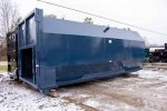 Blue Octagon Packer, or compactor receiver, rolloff container with rectangular opening