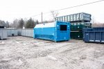 Light blue octagon style compactor receiver with custom heigh for rectangular opening and outriggers