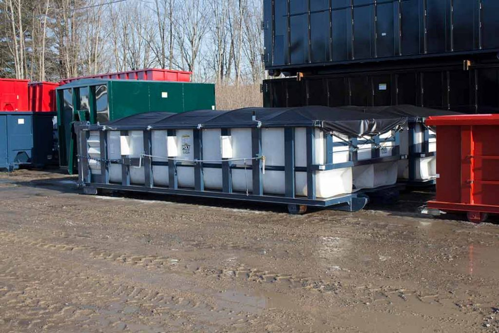 Blue Poly Box rolloff container with white poly material, side roll tarp system, and cable hookup