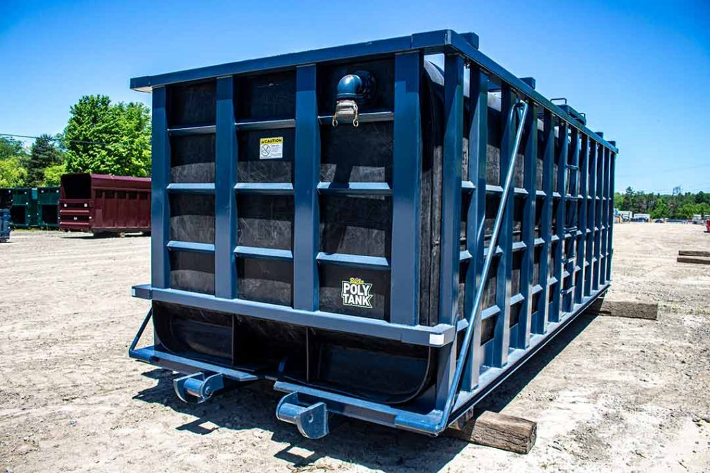 Blue Poly Tank roll off container with crossmembers on top and cable hookup