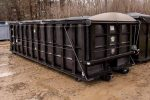 Black Poly Box rolloff container with custom retractable tarp system and cable hookup