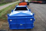 double rolling roof roll-off container with lids open