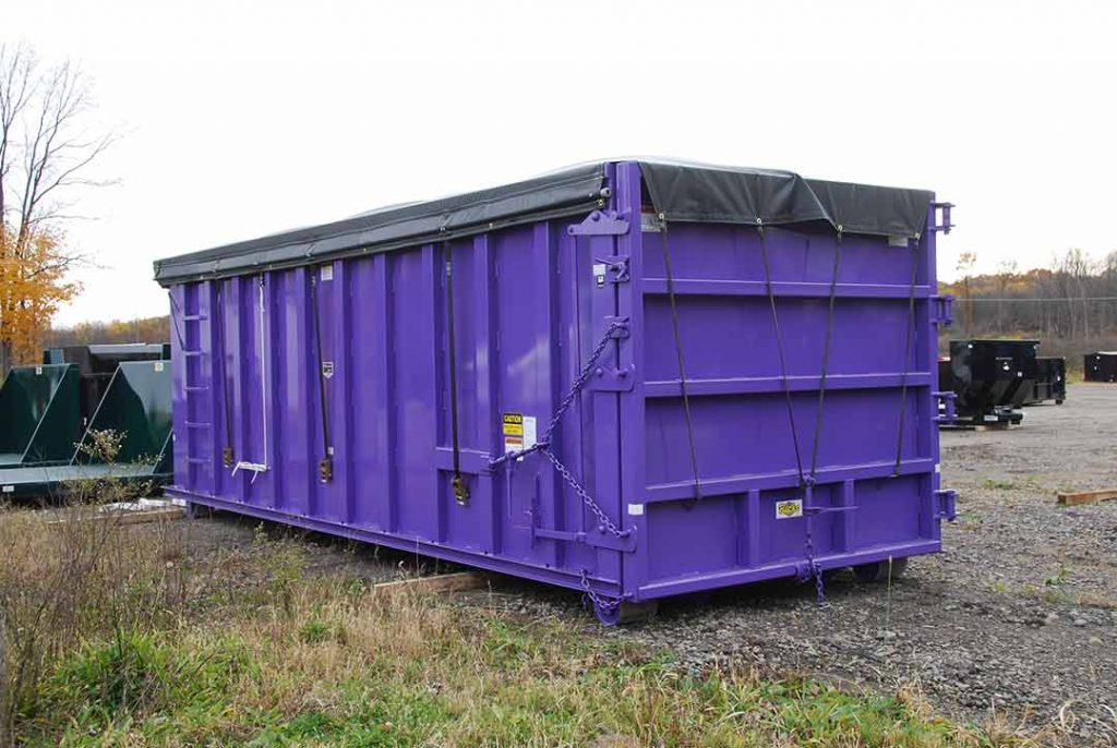 Purple sealed style rolloff container with side roll tarp system and cable style hookup