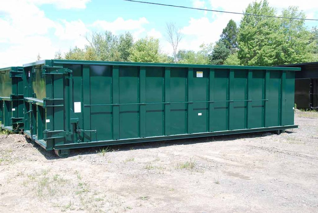 Green sealed style rolloff container with cable style hookup and sealed tailgate