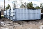 Gray sealed style rolloff container with cable style hookup