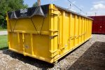 Yellow sealed style rolloff container with side roll tarp system