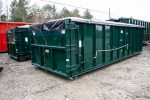 Green sealed style rolloff container with cable hookup and side roll tarp system