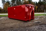 Red security style rolloff container with interior side posts, hooklift hookup, and security style doors