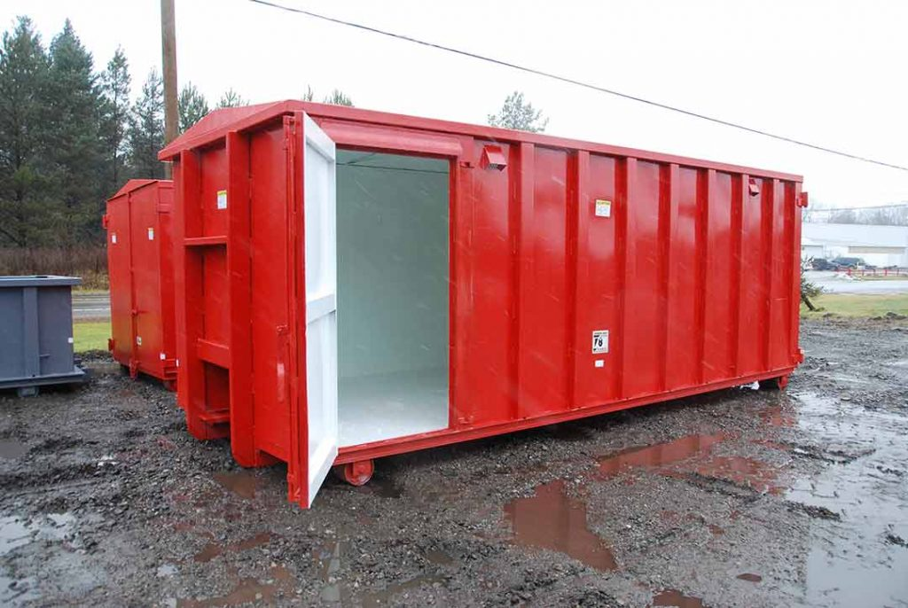 Red security style rolloff container with cable style hookup, security style doors, air vents, and open side door
