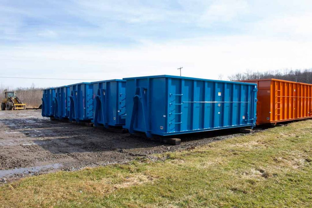 Blue Strong Box rolloff containers with hooklift style hookup and single side swing tailgate