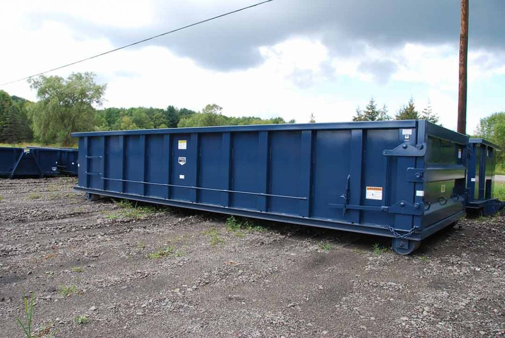 Blue Strong Box rolloff container with cable style hookup and single side swing tailgate