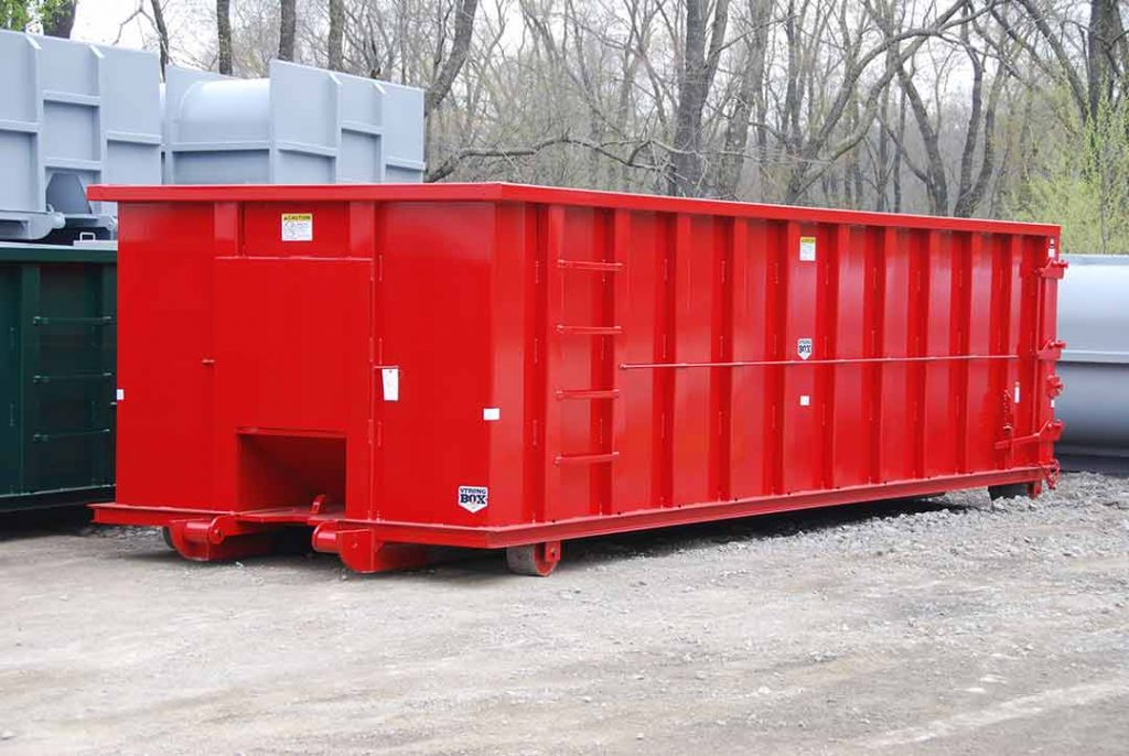 Red Strong Box rolloff container with single side swing tailgate and push plate