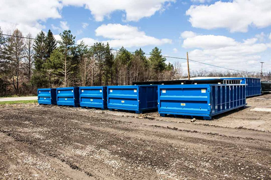 Blue Strong Box rolloff containers with single side swing tailgates and cable hookups