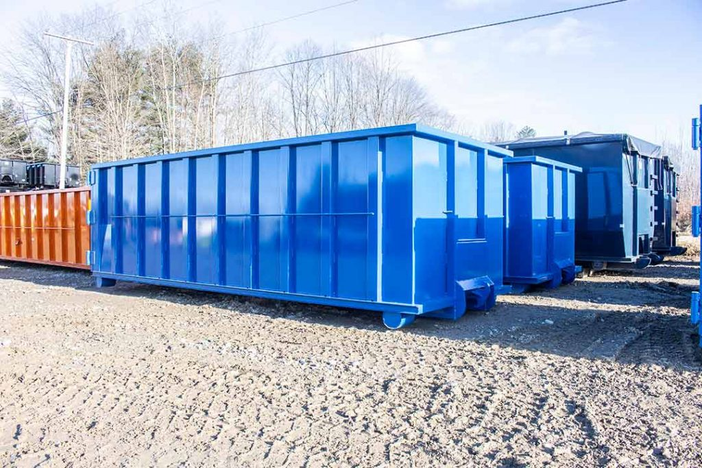 Blue Strong Box rolloff containers with single side swing tailgate and dino style hookup