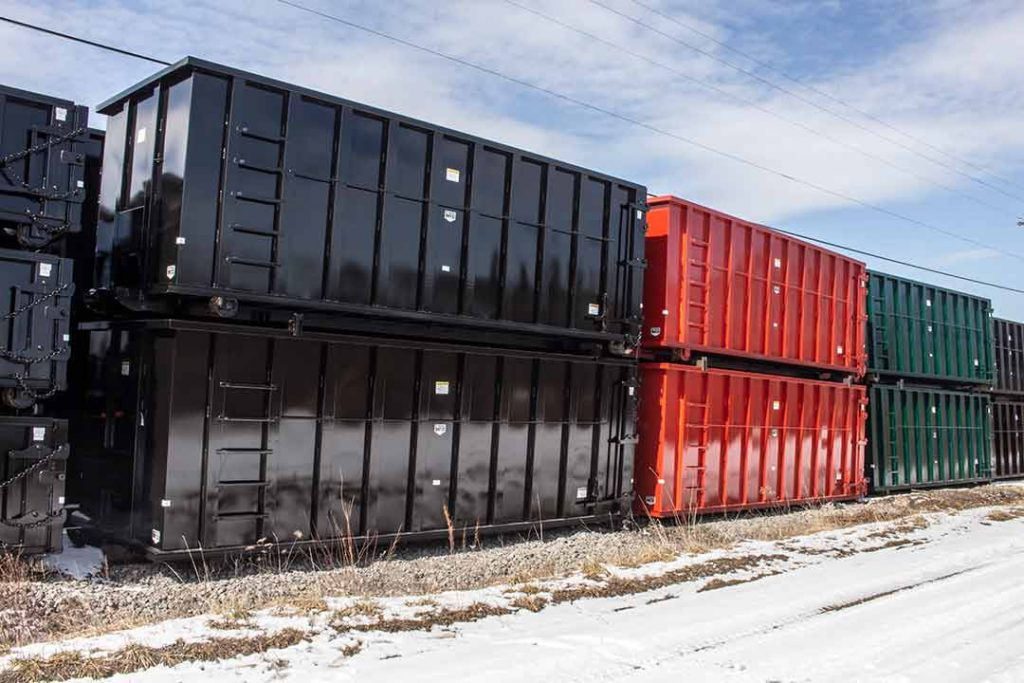40YD standard Strong Box rolloff containers stacked in the yard in stock