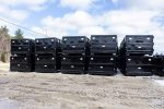 Black standard Tough Box roll off containers stacked in the yard in 30yd