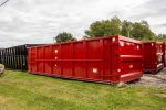 Red Tough Box rolloff container with cable style hookup and single side swing tailgate