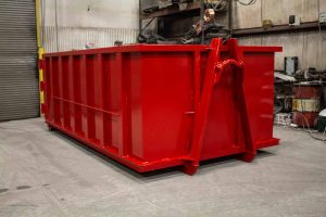 Red Tough Box rolloff container with hooklift style hookup and single side swing tailgate