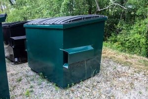 Green 4YD Trash Box front load small can container outsside with lids on, fork pockets, and drain plug