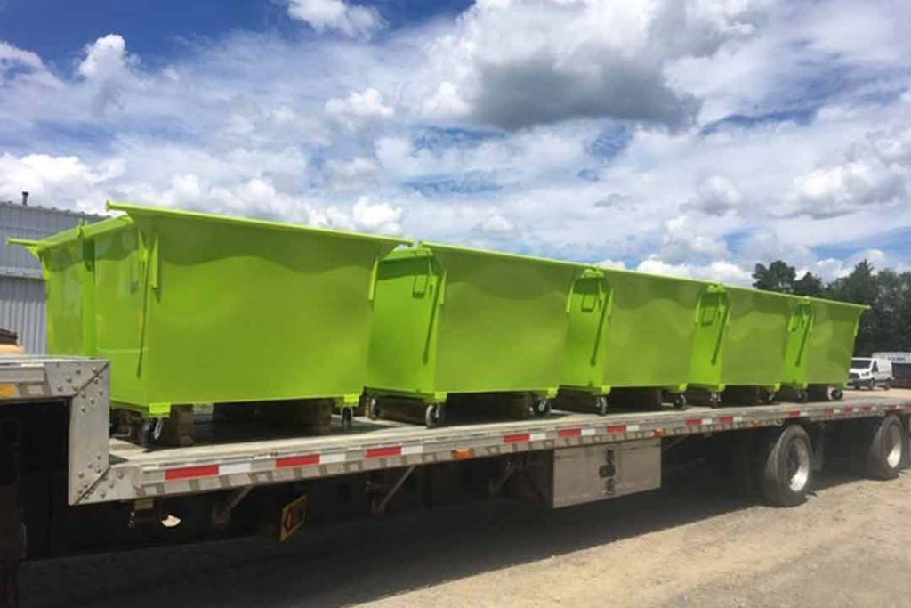 Lime green 2YD Trash Box rear load small can containers with casters on truck ready to ship