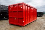 Red Ultra Box rolloff container with heavy duty top rails, sealed 9 panel tailgate, and side stiffeners