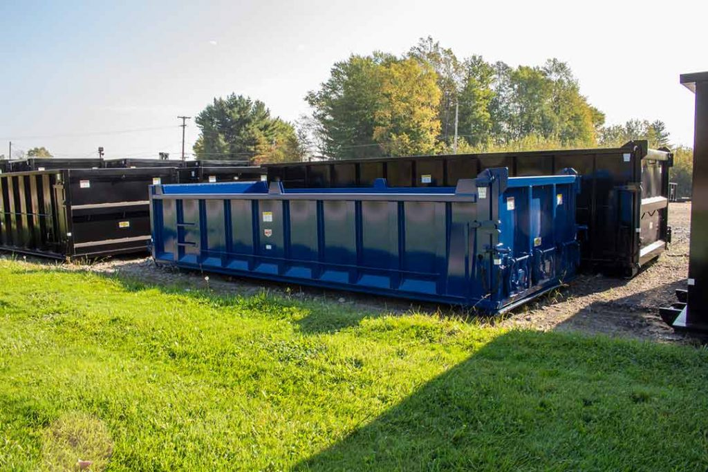 Blue Ultra Box dump style rolloff container with dirt shedders, dump gate with coal chutes, and board pockets