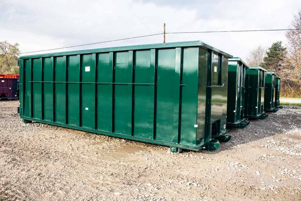 Green Ultra Box rolloff container with interted angle, cable style hookup and push plate