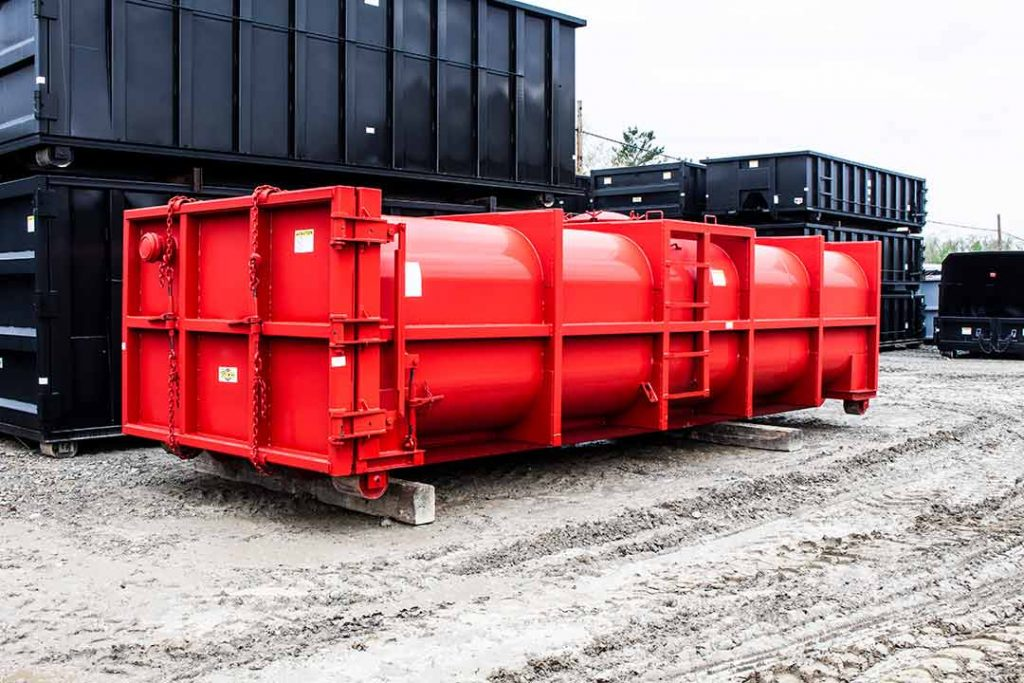 Red Vacuum tank rolloff container with a single pipe and nipple cap flange